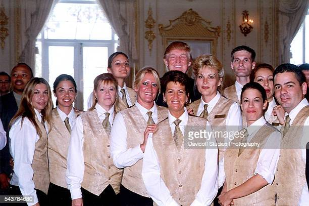Group portrait the staff of the MaraLago estate as they pose with businessman Donald Trump on Mother's Day Palm Beach Florida May 14 2006