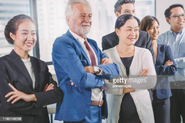 group portrait young creative business person working success project with team business people weare casual suit outfit working happy action in modern coworking space - free business coaching stock pictures, royalty-free photos & images