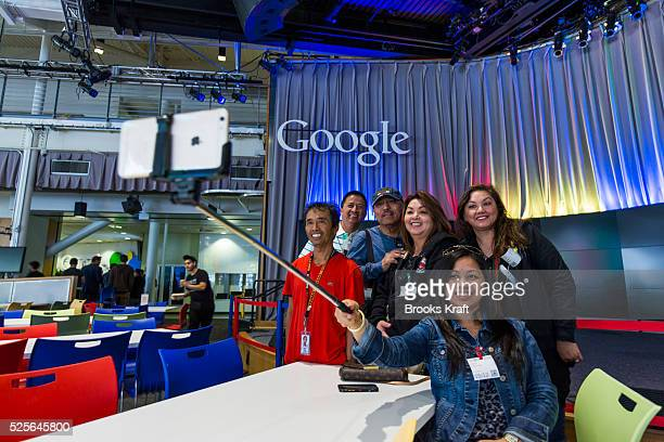 A group poses for a selfie inside Charlie's Cafe at the Googleplex the corporate headquarters of Google Inc located in Mountain View California