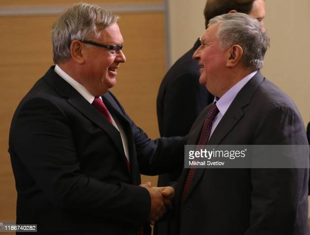 VTB Group President Andrei Kostin greets Roneft President Igor Sechin during the meeeting with German businessmen on December 6 2019 in Sochi Russia...