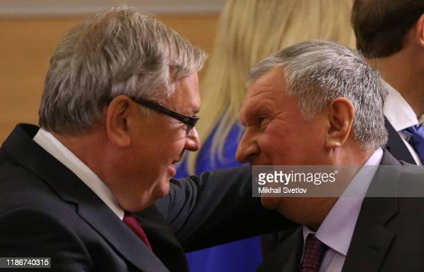 VTB Group President Andrei Kostin greets Rosneft President Igor Sechin during the meeeting with German businessmen on December 6 2019 in Sochi Russia...