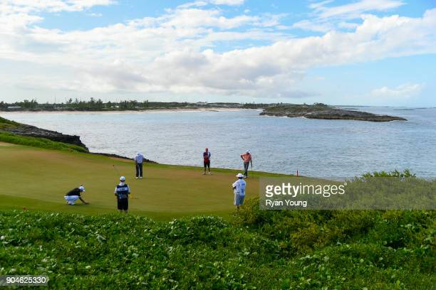 A group putts on the 13th green during the first round of the Webcom Tour's The Bahamas Great Exuma Classic at Sandals Emerald Bay Emerald Reef...