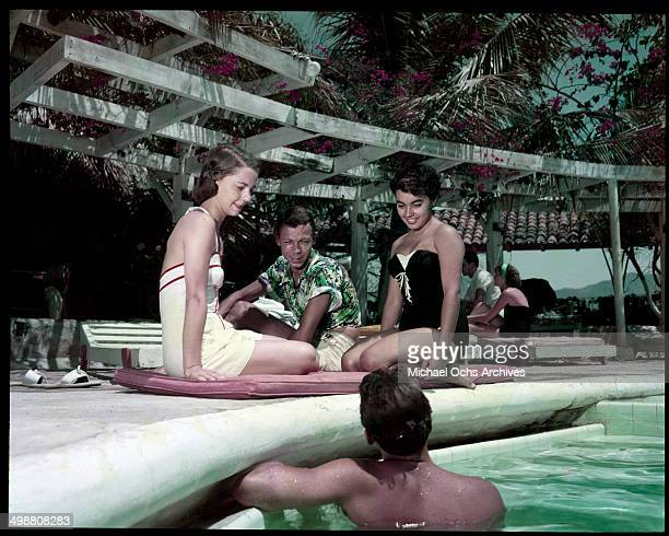 A group rest and relax at the pool in Acapulco Mexico in July 1953