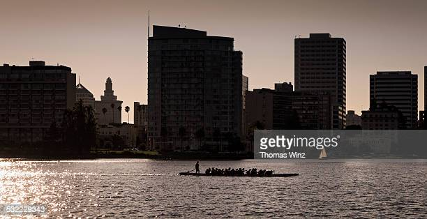 group row boat on lake merritt - oakland california skyline stock pictures, royalty-free photos & images