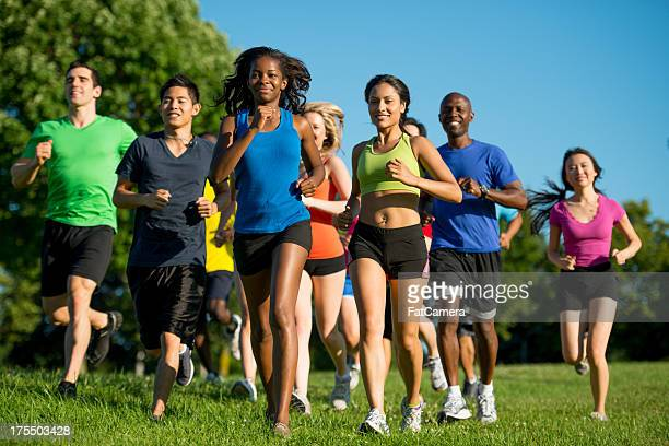 group run - 5000 meter stock pictures, royalty-free photos & images