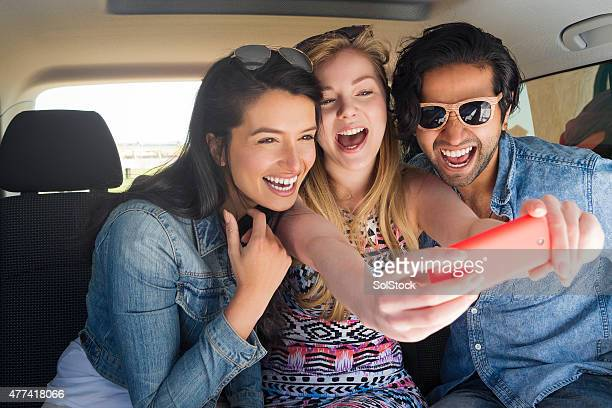 Group Selfie in a Taxi