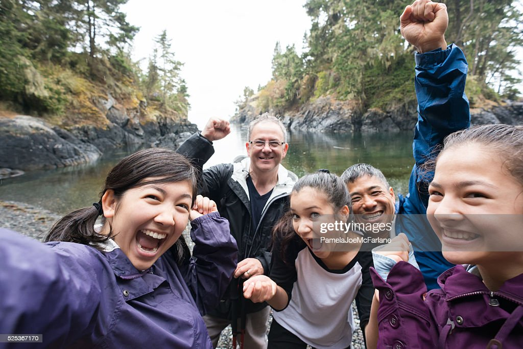 Group Selfie of Hikers in Rain on Wilderness Beach, Canada : Stock Photo