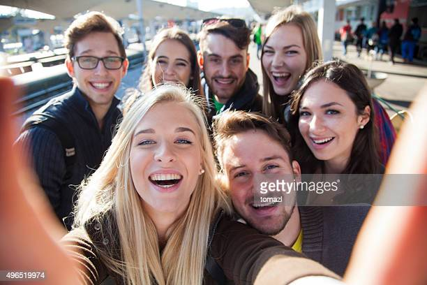 Group selfie of young people traveling