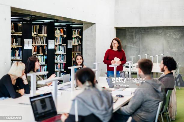 group seminar in public library - library stock pictures, royalty-free photos & images