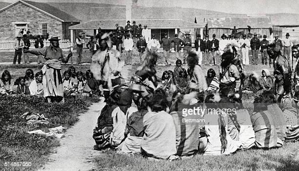 A group Shoshoni dance at the Fort Washakie reservation in Wyoming Standing at far left with his arm outstretched is Chief Washakie