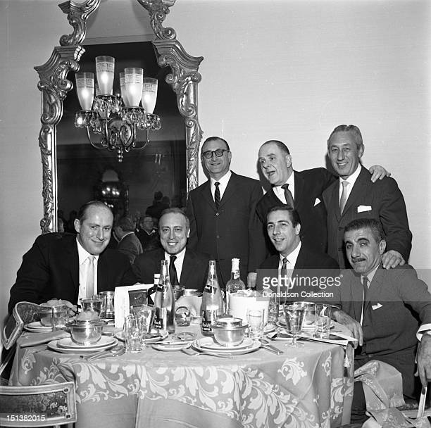 A group shot at a dinner for the Motion Picture Pioneers Association at the Playboy Club on November 19 1962 in New York New York