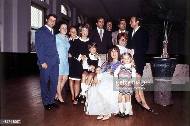 Group shot for the Italian cinematographic actor Giuliano Gemma and his wife, the painter Natalia Roberti, posing with relatives and friends in the...