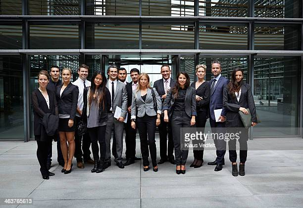 Group shot of business people outside corporation