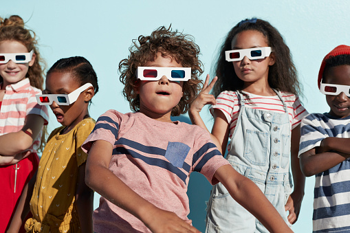 Group shot of cool kids wearing 3-D glasses while playing and posing - gettyimageskorea