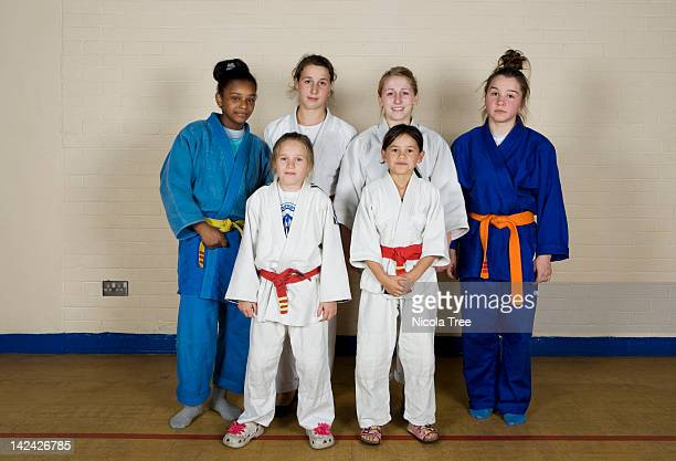 a group shot of girls from the junior judo club. - martial arts stock pictures, royalty-free photos & images