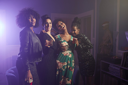 Group shot of happy young women dancing at home party - gettyimageskorea