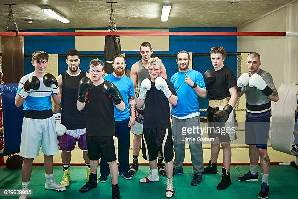 Group shot of male boxers and their trainers