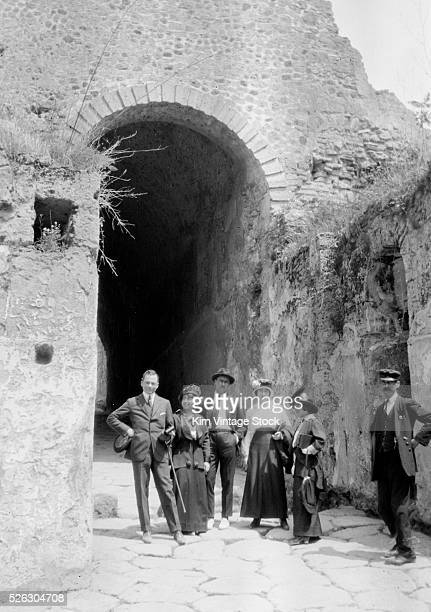 Group shot of travelers at gateway possibly on the Island of Capri Naples Italy in the early 20th century