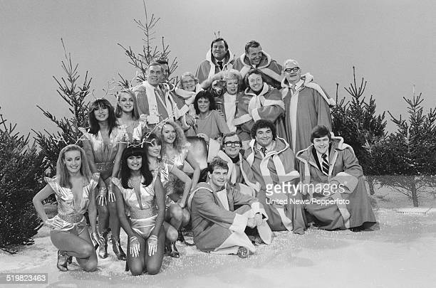 Group shot of various comedians actors dancers and television presenters dressed in festive costumes taking part in a photo call to promote BBC...