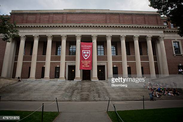 A group sits on the steps of Widener Library at the Harvard University campus in Cambridge Massachusetts US on Tuesday June 30 2015 Harvard...