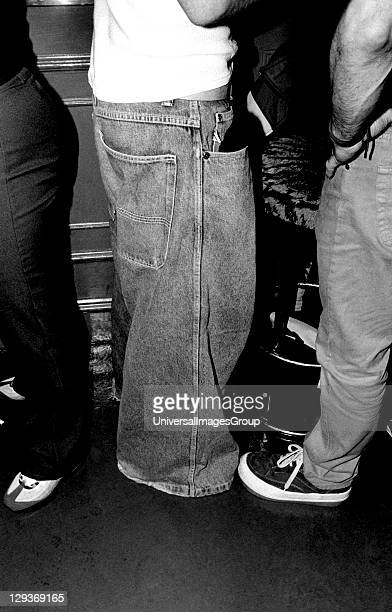 A group stood at a bar one of them wearing wide baggy jeans Brighton UK 1990's