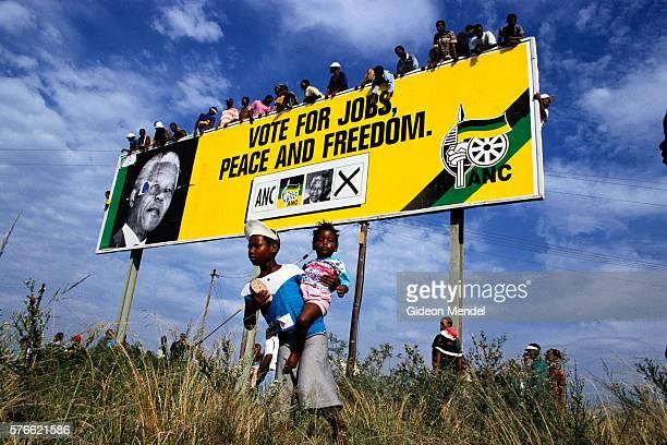 Group Surrounding Nelson Mandela Campaign Billboard