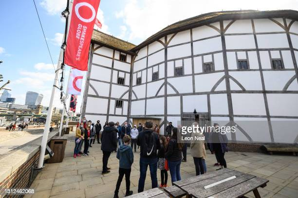 Group takes part in a guided tour following the re-opening of The Globe Theatre on April 14, 2021 in London, England. Running from May 19 to October...
