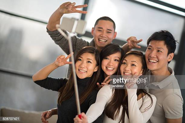 Group talking a selfie with a stick