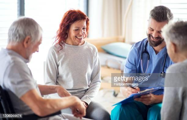 a group therapy of patients with walking difficulties in hospital. - bewustwording over geestelijke gezondheid stockfoto's en -beelden