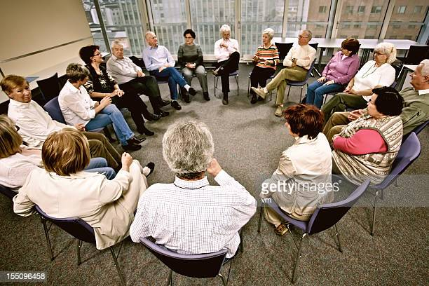 group therapy - community centre stock pictures, royalty-free photos & images