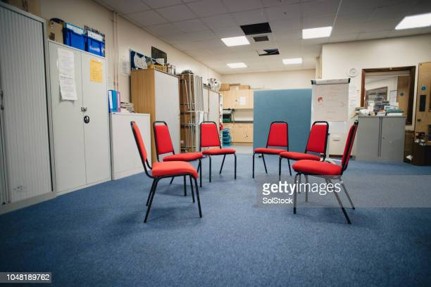 group therapy room - community center stock pictures, royalty-free photos & images