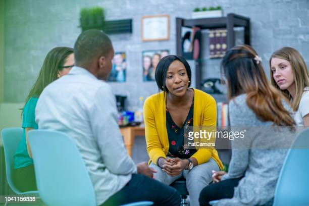group therapy session - social issues stock pictures, royalty-free photos & images