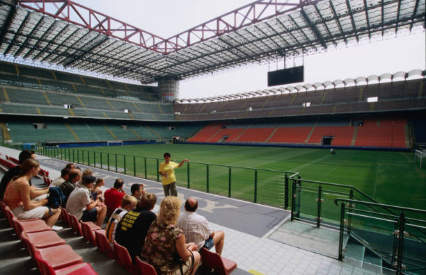 Group touring soccer stadium San Siro of Internazionale Milano and AC Milano.