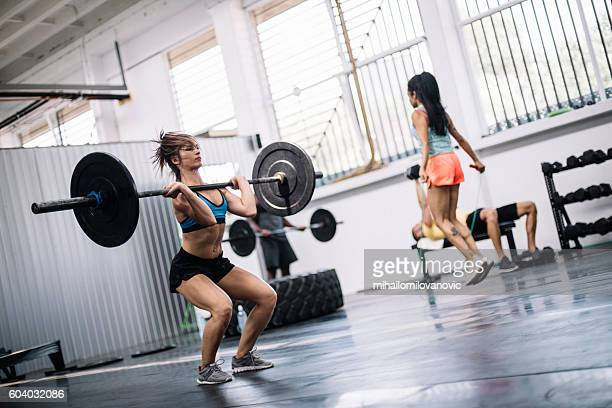 group training - black female bodybuilder stock photos and pictures