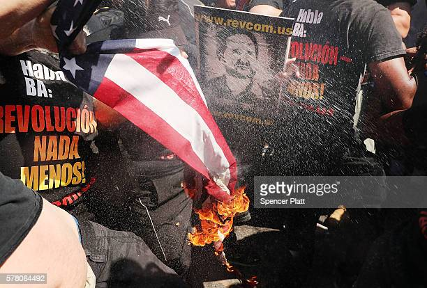 A group tries to burn an American Flag as police move in near the site of the Republican National Convention in downtown Cleveland on the third day...