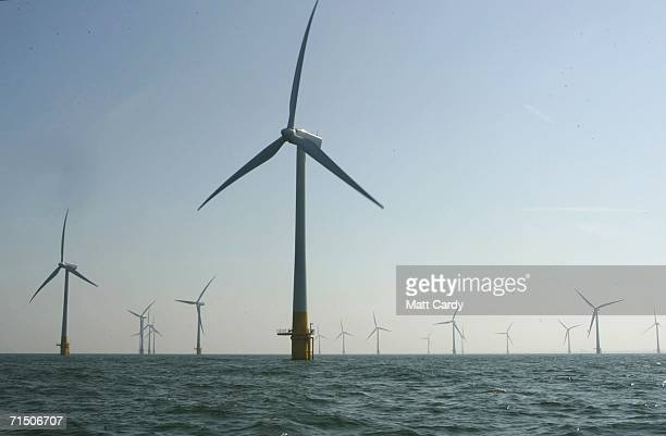 A group turbines from Britain's largest offshore wind farm stand off the Great Yarmouth coastline on July 19 2006 in Norfolk England The 30 turbines...