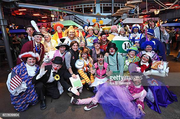 Group Vice President Macy's Parade and Entertainment Group Amy Kule poses with a group of professional clowns as Macy's prepares for the 90th Macy's...