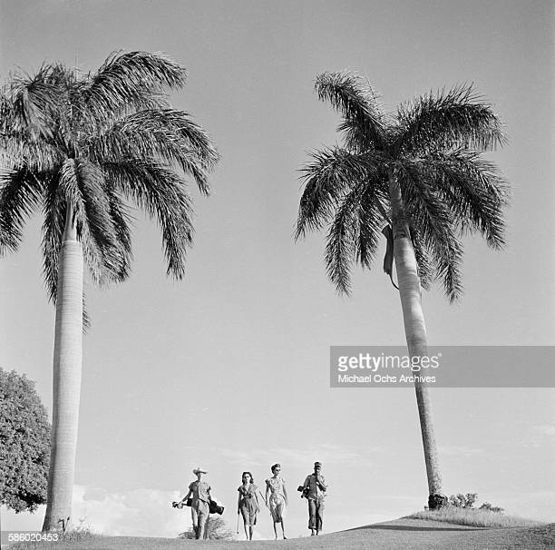 A group walks the golf course during a golf game in Havana Cuba