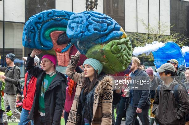 A group walks with a two section cut out of a brain at the March for Science on April 14 in downtown Portland OR
