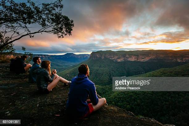 A group watch sunrise in the Blue Mountains.