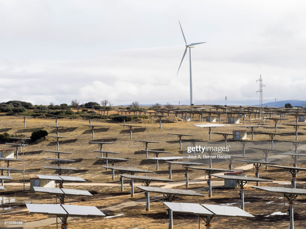 Group Wind Turbines And Solar Panels In The Landscape Two