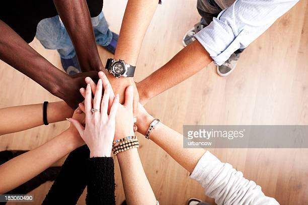 Group with hands together