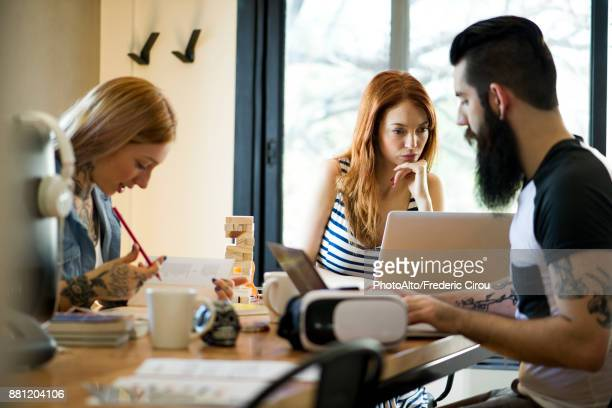 Group working together in shared office space