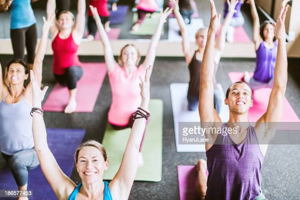 group yoga class in studio - brightly lit stock pictures, royalty-free photos & images
