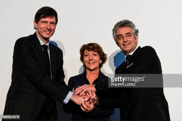 Groupama insurance group director Thierry Marte, sport director of the FDJ cycling team Marc Mardiot and FDJ President Stephane Pallez pose after a...