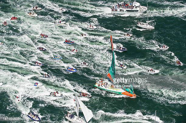 Groupama Sailing Team, skippered by Franck Cammas from France, are followed in by a huge fleet of spectator boats, after claiming victory in the...