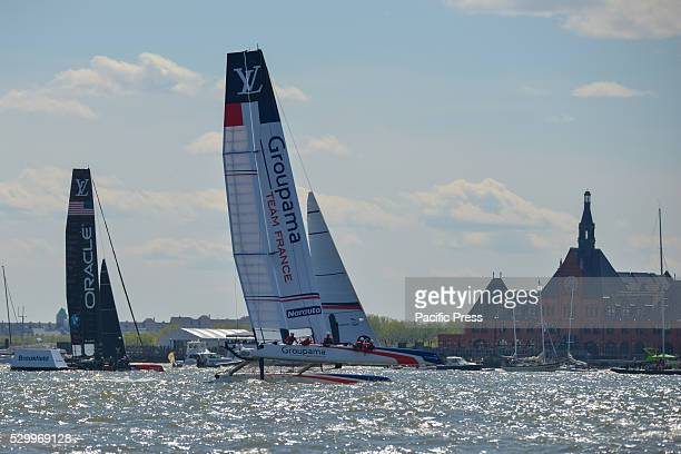Groupama Team France and Oracle Team USA head for a marker near the New Jersey shoreline during the third race Six competitors for the Louis Vuitton...