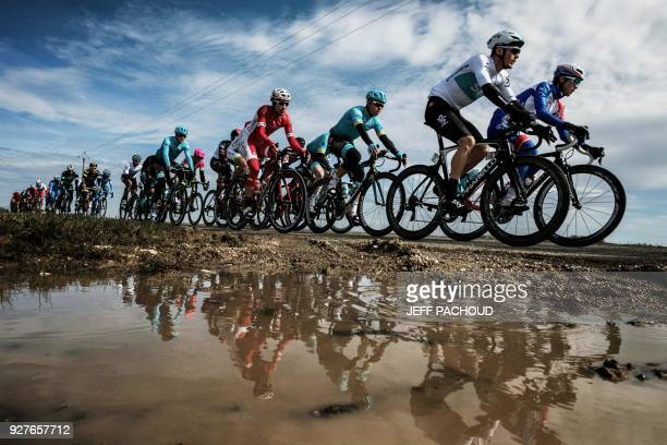TOPSHOT GroupamaFDJ French rider Rudy Molard and Team Sky Dutch rider Dylan van Baarle ride with the pack during the second stage of the Paris Nice...