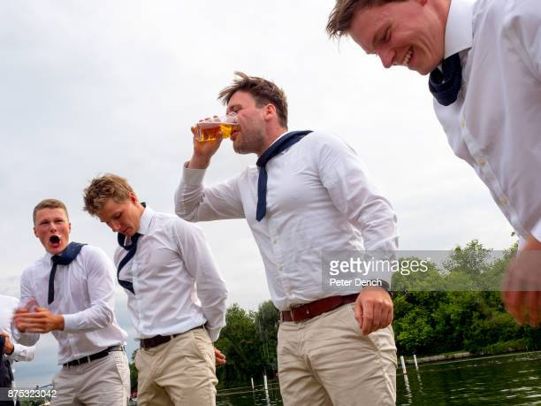 A groupf of German friends play a beer boat drinking game Henley Royal Regatta is a rowing event held annually on the River Thames by the town of...