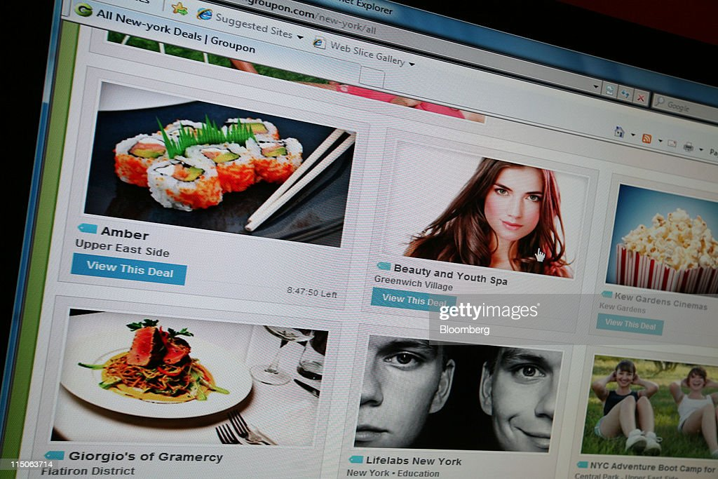 Groupon Inc.'s homepage on a monitor in New York, U.S., on Thursday, June 2, 2011. Groupon Inc., the largest provider of online coupons, filed to raise $750 million in an initial public offering, giving shareholders a chance to bet on the burgeoning daily-deal market. Photographer: Joseph Valenti/Bloomberg via Getty Images